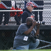 New Journal photographer Andre Smith taking images from the sidelines during a regular season football game between William Penn and Concord Saturday, Oct. 24, 2015 at  William Penn High School in New Castle.
