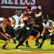 24 November 2018: San Diego State Aztecs quarterback Christian Chapman (10) scrambles with the ball for a short gain in the first quarter. The Aztecs closed out the season with a 31-30 overtime loss to Hawaii at SDCCU Stadium.