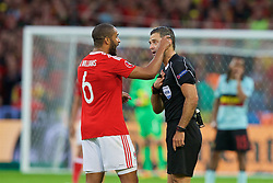 LILLE, FRANCE - Friday, July 1, 2016: Referee Damir Skomina speaks with captain Ashley Williams during the UEFA Euro 2016 Championship Quarter-Final match against Belgium at the Stade Pierre Mauroy. (Pic by Paul Greenwood/Propaganda)
