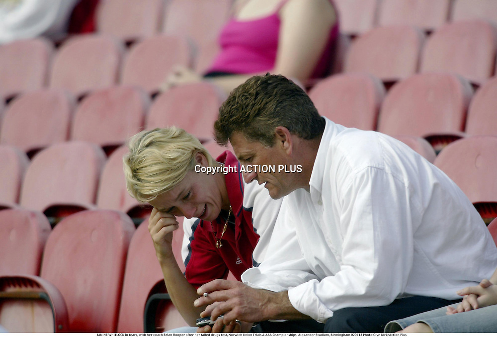 JANINE WHITLOCK in tears, with her coach Brian Hooper after her failed drugs test, Norwich Union Trials &amp; AAA Championships, Alexander Stadium, Birmingham, 13 July 2002<br />