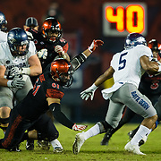 18 November 2017:  The San Diego State football team hosts Nevada Saturday night. San Diego State Aztecs defensive lineman Damon Moore (61) breaks into the back field and attempts to tackle Nevada Wolf Pack running back Jaxson Kincaide (5) in the third quarter. The Aztecs beat the Wolf Pack 42-23 at SDCCU stadium. <br /> www.sdsuaztecphotos.com