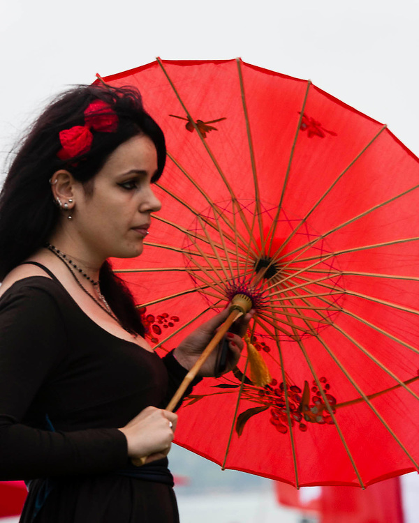 A girl walks with a japanese umbrella during the Japan Festival in Lisbon