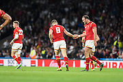 Wales scrum half Gareth Davies is congratulated by Wales centre Jamie Roberts after scoring a try during the Rugby World Cup Pool A match between England and Wales at Twickenham, Richmond, United Kingdom on 26 September 2015. Photo by David Charbit.
