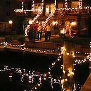 George McCuiston's house on Canal Drive, was lit up and provided a delightful scene for guests to enjoy the brightly lit boats...McCuiston, George.419 Canal Dr.Carolina Beach, NC 28428.(910) 458-5506