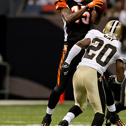 2009 August 14: Cincinnati Bengals wide receiver Chris Henry (15) born in Belle Chasse, Louisiana  catches a pass in front of New Orleans Saints cornerback Randall Gay (20) during a preseason opener between the Cincinnati Bengals and the New Orleans Saints at the Louisiana Superdome in New Orleans, Louisiana.  Henry died on the morning of December 17, 2009 after suffering injuries he sustained after falling from the back of a pick up truck, Henry was 26-years old.