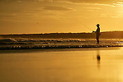 Beach fishing at sunset, & Mile beach, Gerroa, South Coast, NSW, Australia