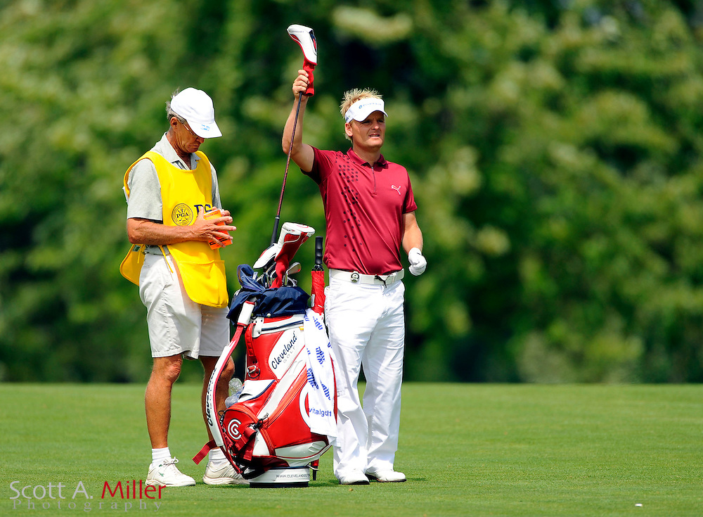 Aug 16, 2009; Chaska, MN, USA; Soren Kjeldsen (DEN) pulls a club out of his bag on the third fairway during the final round of the 2009 PGA Championship at Hazeltine National Golf Club.  ©2009 Scott A. Miller