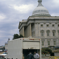 U.S. Capitol Police officer inspects a truck at the driveway entrance to the U.S. Capitol in 1986