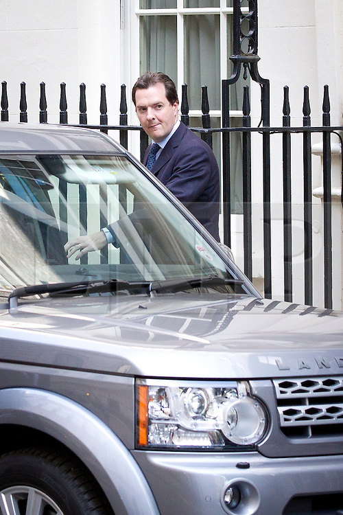"© Licensed to London News Pictures. 29/08/2013. London, UK. Chancellor of the Exchequer George Osborne leaves a meeting of the British cabinet on Downing Street in London today (29/08/2013) as a recalled British Parliament prepares to debate the possibility of ""direct"" military action over recent reports an alleged chemical weapons attack in Syria. Photo credit: Matt Cetti-Roberts/LNP"