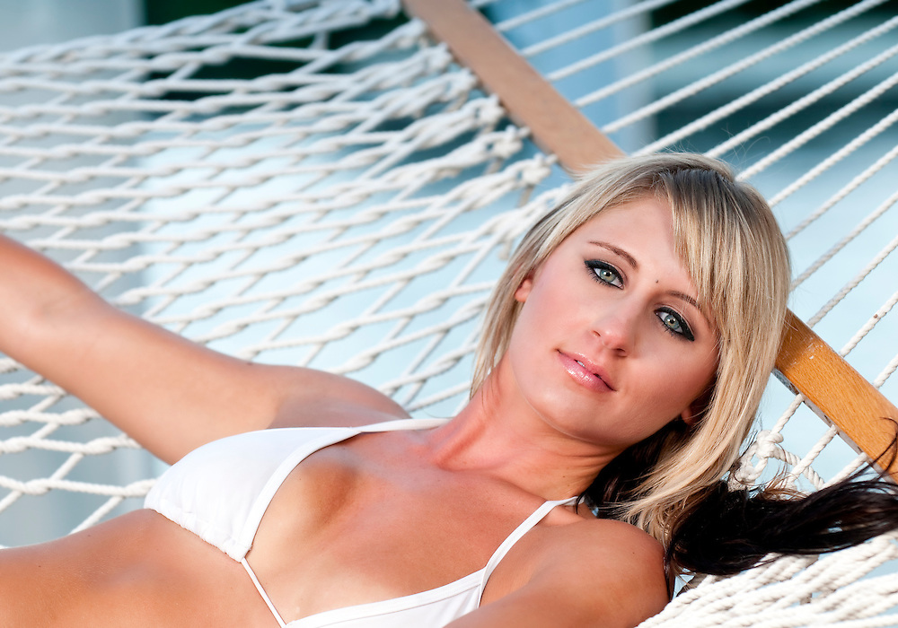 Very sensual caucasian girl resting in a hammock in the summer.
