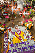 A gravesite decorated with an elaborate floral pedal tapestry in honor of the deceased at the San Antonino Castillo cemetery during the Day of the Dead Festival known as Día de Muertos on November 3, 2013 in San Antonino Castillo Velasco, Oaxaca, Mexico.
