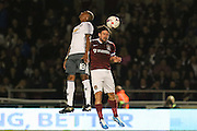Ashley Young Midfielder of Manchester United battles in the air with Northampton Town defender David Buchanan (3) during the EFL Cup Third Round match between Northampton Town and Manchester United at Sixfields Stadium, Northampton, England on 21 September 2016. Photo by Phil Duncan.