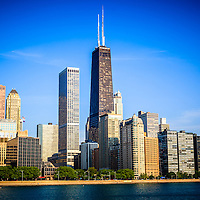 Picture of Chicago skyline with John Hancock Center skyscraper building. Scene is located in the Northern Streeterville area of Chicago with lake Michigan in the forground. Photo is high quality and high resolution.