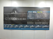 A placard shows a timeline and facts about the USS Iowa where the battleship saw duty during World War II operations while now docked as a museum and tourist attraction in the San Pedro Harbor on November 30, 2013 in Los Angeles, California. ©Paul Anthony Spinelli