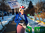 14 JANUARY 2020 - DES MOINES, IOWA: CAROL DUNITZ, Ann Arbor, MI, dressed as Uncle Sam before the CNN Democratic Presidential Debate on the campus of Drake University in Des Moines. She said she was apolitical until the election of Donald Trump and his statements about women and people of color motivated her to get active in politics. She now travels the country against Trump. She said she's trying to make a difference. This is the last debate before the Iowa Caucuses on Feb. 3.    PHOTO BY JACK KURTZ