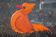 Big orange paper balloon bird above crowd at Lu Ping or Fire Balloon Festival, Taunggyi