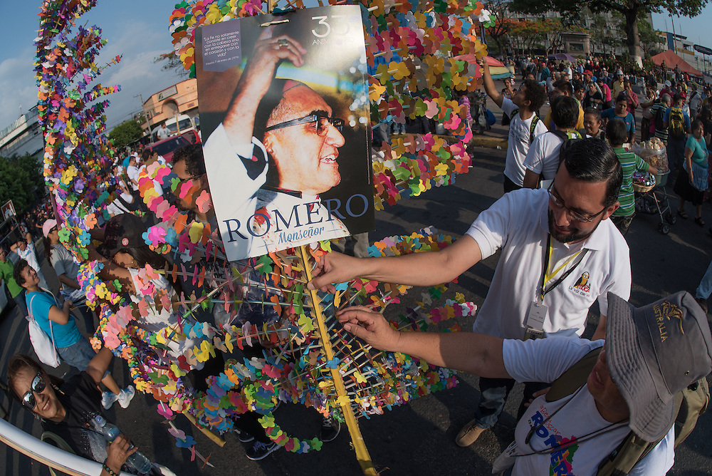 Pilgrims decorate palm fronds with colorful paper flowers as they celebrate the life of martyred Catholic Archbishop Oscar Romero in front of San Salvador's Metropolitan Cathedral.  El Salvador prepares for the beatification ceremony and mass announcing the beatification of Archbishop Oscar Romero. The Archbishop was slain at the alter of his Church of the Divine Providence by a right wing gunman in 1980. Oscar Arnulfo Romero y Galdamez became the fourth Archbishop of San Salvador, succeeding Luis Chavez, and spoke out against poverty, social injustice, assassinations and torture. Romero was assassinated while offering Mass on March 24, 1980.