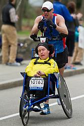 2013 Boston Marathon: handicapped team push through on course