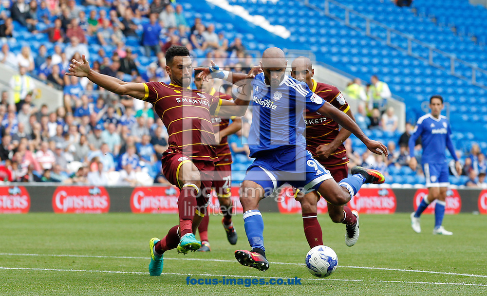 Frederic Gounongbe of Cardiff City and Steven Caulker of Queens Park Rangers during the Sky Bet Championship match at the Cardiff City Stadium, Cardiff<br /> Picture by Mike Griffiths/Focus Images Ltd +44 7766 223933<br /> 14/08/2016