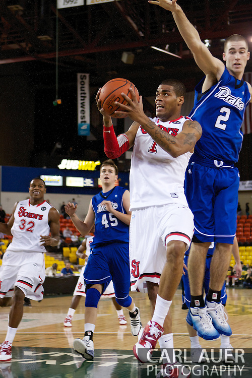 November 26th, 2010:  Anchorage, Alaska - St. John's senior guard D.J. Kennedy (1) attempts a shot in the Red Storm's semi final game of the Great Alaska Shootout against the Drake Bulldogs.  The Red Storm defense held Drake to a tournament low score as St. Johns advanced to the final game 82-39.