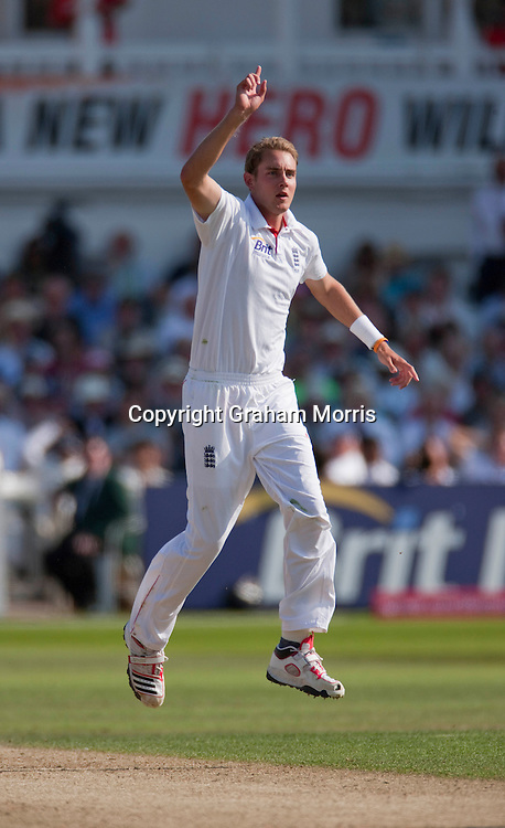 Stuart Broad celebrates the wicket of Mahendra Singh Dhoni (the first of his hat-trick) during the second npower Test Match between England and India at Trent Bridge, Nottingham.  Photo: Graham Morris (Tel: +44(0)20 8969 4192 Email: sales@cricketpix.com) 30/07/11