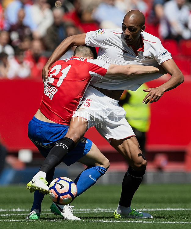Steven N'zonzi of Sevilla FC in duel with Xavi Torres of Sporting Gijon during the Spanish championship Liga football match between Sevilla FC and Sporting Gijon on April 2, 2017 at Sanchez Pizjuan stadium in Sevilla, Spain - photo Cristobal Duenas / Spain / ProSportsImages / DPPI