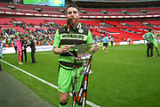 Forest Green Rovers Sam Wedgbury(8) with the trophy  during the Vanarama National League Play Off Final match between Tranmere Rovers and Forest Green Rovers at Wembley Stadium, London, England on 14 May 2017. Photo by Shane Healey.
