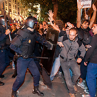 "25/09/2012. Riot policemen charge during a demonstration organized by Spain's ""indignant"" protesters to decry an economic crisis they say has ""kidnapped"" democracy, on September 25, 2012 in Madrid. Spanish riot police fired rubber bullets and baton-charged protesters as thousands rallied near parliament in Madrid in anger at the government's handling of the economic crisis. ©Sylvain Cherkaoui"