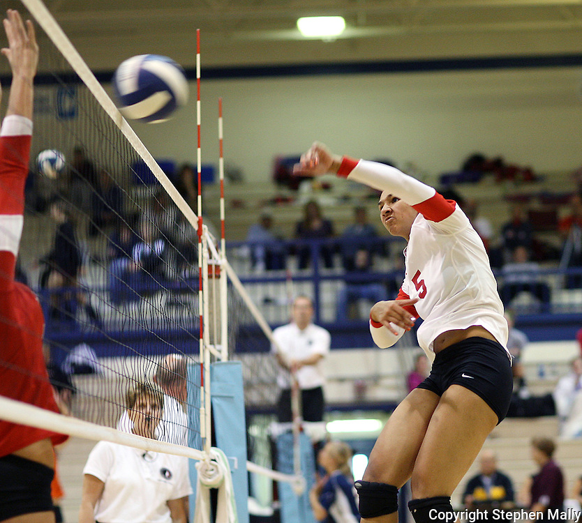 Marion senior Morgan Paige (5) spikes the ball over the net in their match again Davenport West at the Westside Volleyball Invitational at Jefferson High School in Cedar Rapids on Saturday October 10, 2009.  Marion won the match 21-13, 21-11.