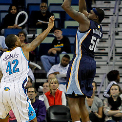 December 21, 2011; New Orleans, LA, USA; Memphis Grizzlies power forward Zach Randolph (50) shoots over New Orleans Hornets forward Lance Thomas (42) during a preseason game at the New Orleans Arena.   Mandatory Credit: Derick E. Hingle-US PRESSWIRE