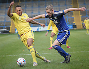 Kingsley James (Halifax) tries to get to the ball as Adam Smith (Guiseley) runs past him during the Conference Premier League match between FC Halifax Town and Guiseley at the Shay, Halifax, United Kingdom on 5 December 2015. Photo by Mark P Doherty.