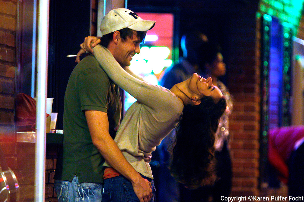 December 20, 2012 - Paige Wilkerson of Lakeland and Lance Sneed of Bartlett, didn't need any mistletoe to celebrate. About 1am along Beale Street, couple stroll, neck , dance and bar hop with little care about the time of night.   (Karen Pulfer Focht / The Commercial Appeal)