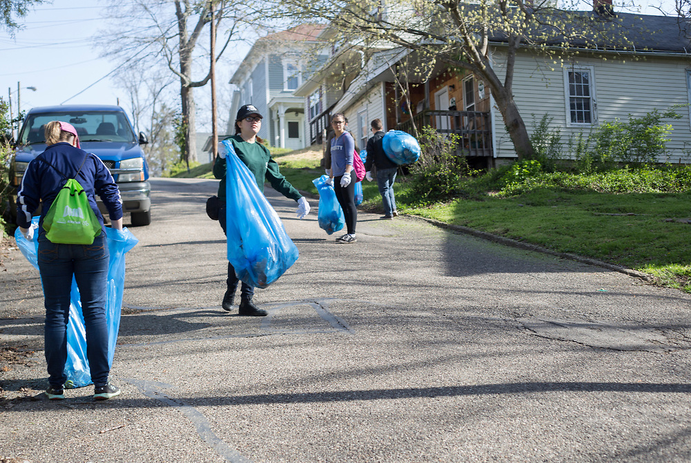 Volunteers picks up trash on Mound Street during Athens Beautification Day on April 9, 2017.