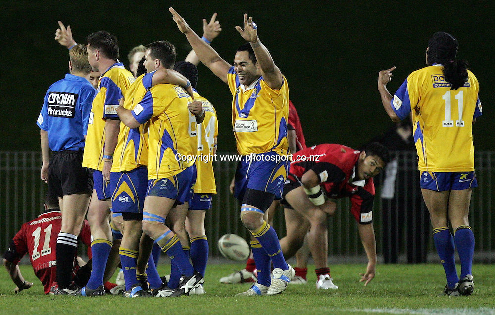 The Mt. Albert Lions celebrate after winning the Bartercard Cup Final rugby league match between the Mt. Albert Lions and the Canterbury Bulls at Mt. Smart Stadium, Auckland, New Zealand on Monday 18 September, 2006. Photo: Hannah Johnston/PHOTOSPORT<br /><br /><br />180906