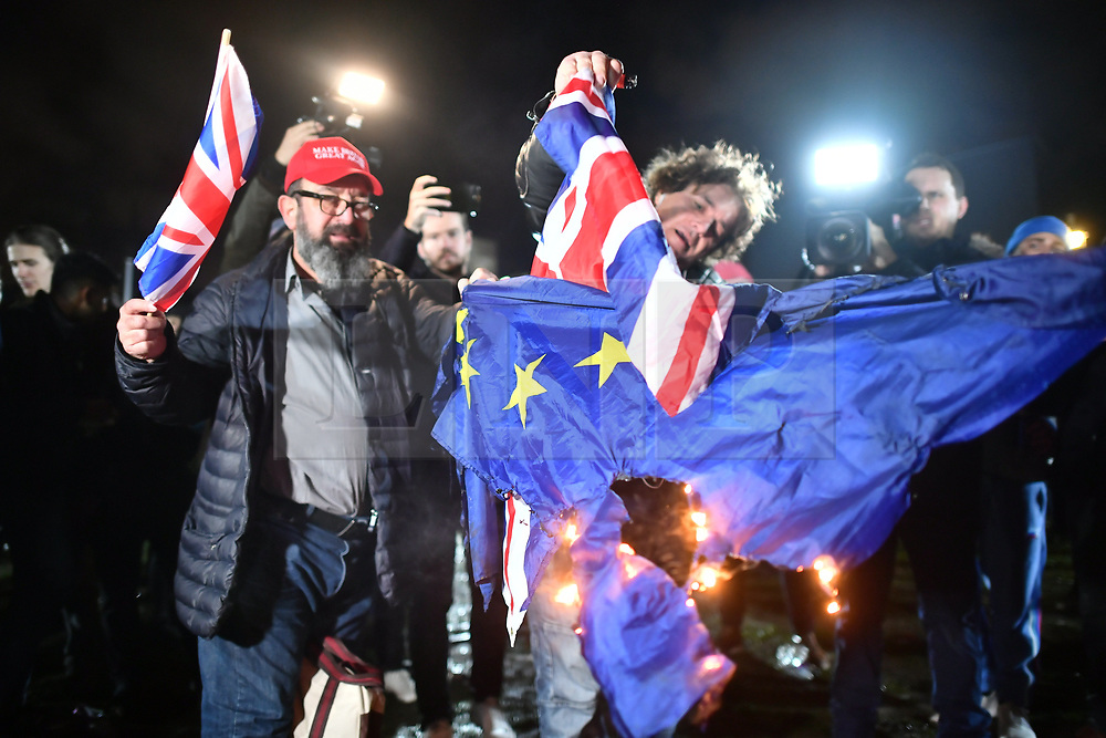 © Licensed to London News Pictures. 31/01/2020. London, UK. The EU flag being burnt shortly after 11pm, as Supporters of Brexit celebrate in Westminster, London, as the UK leaves the European Union. 51. 9% of the UK population voted to leave the EU in a referendum in June 2016. Photo credit: Ben Cawthra/LNP