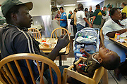 Larry feeds Lawrance at Loaves and Fishes, its a place where the homeless can have a hot meal once a day and  hang out.....