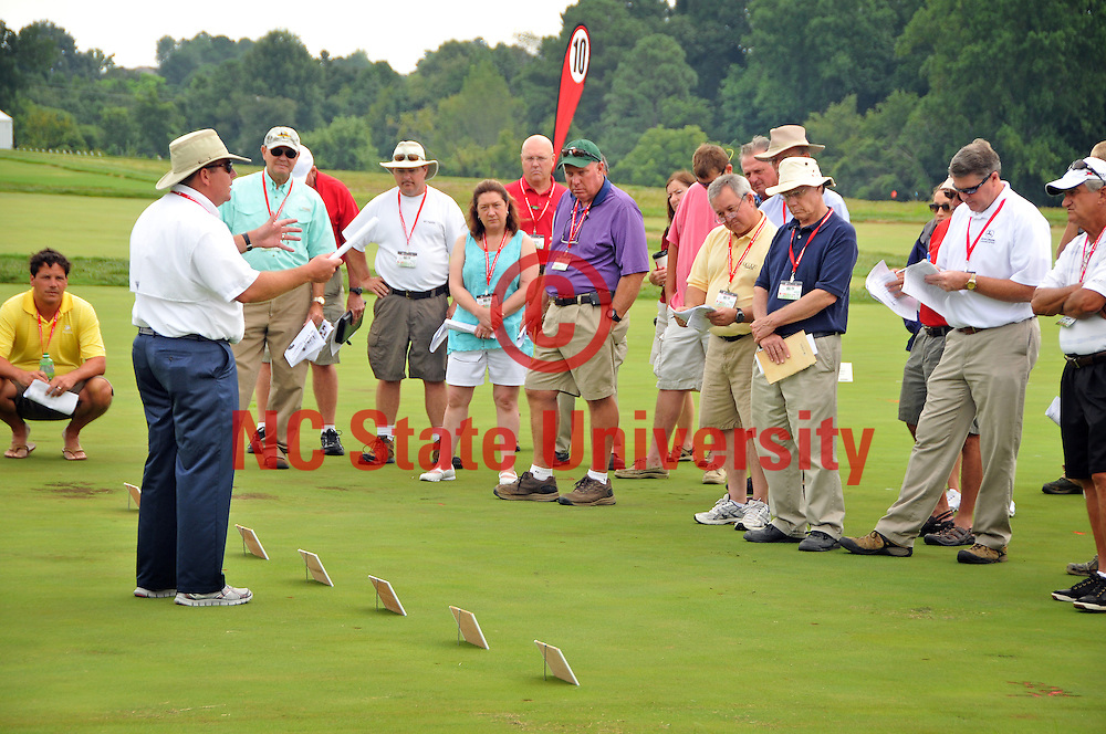 Plant Pathology assistant professor and extension specialist Jim Kerns speaks on 'Fungicides for Control of Creeping Bentgrass Putting Green Diseases' at the annual Turfgrass Field Day.