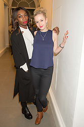 Left to right, actress MICHAELA COEL and actress HOLLI DEMPSEY at the opening of the exhibition Champagne Life in celebration of 30 years of The Saatchi Gallery, held on 12th January 2016 at The Saatchi Gallery, Duke Of York's HQ, King's Rd, London.