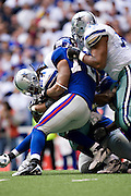 IRVING, TX - JANUARY 13:   Marion Barber #24 of the Dallas Cowboys is tackled by Osi Umenyiora #72 of the New York Giants during the NFC Divisional playoff at Texas Stadium on January 13, 2008 in Dallas, Texas.  The Giants defeated the Cowboys 21-17.  (Photo by Wesley Hitt/Getty Images) *** Local Caption *** Marion Barber;Osi Umenyiora