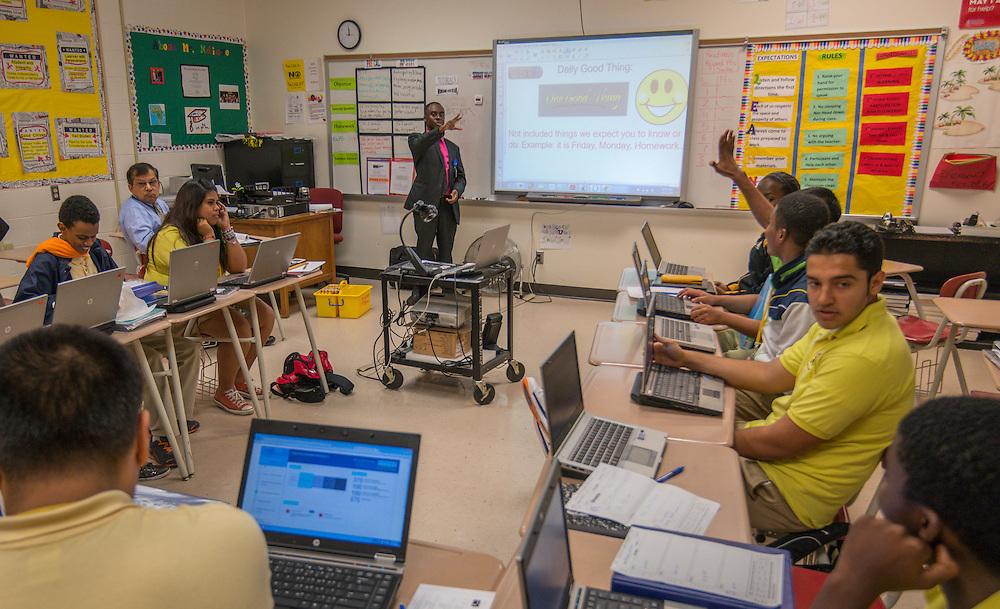 "Math teacher Dahirou Ndiaye asks students to share ""One Good Thing"" at the start of an AP Statistics class at Lee High School, November 21, 2013."