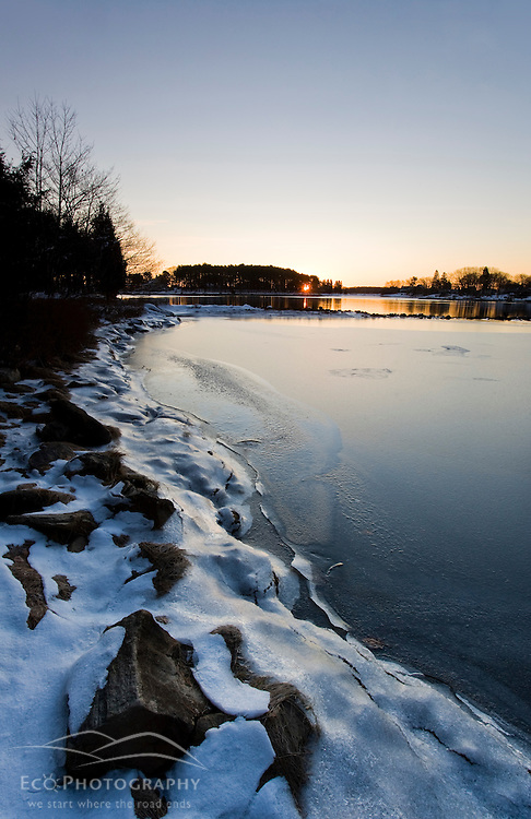 Sunrise over Sagamore Creek and a frozen tidal pond in Portsmouth, New Hampshire.