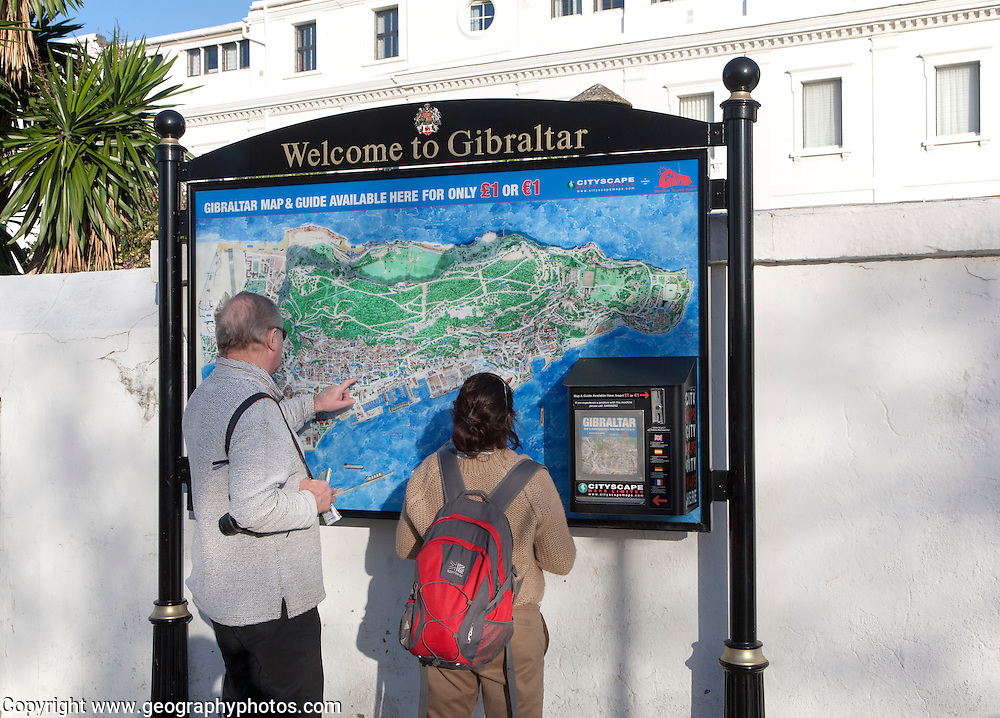 Two people looking at a map near Bristol Hotel, Gibraltar, British terroritory in southern Europe