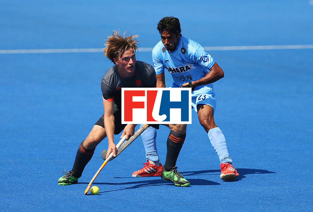 LONDON, ENGLAND - JUNE 20:  Jorrit Croon of the Netherlands is watched by Pardeep Mor of India during the Pool B match between India and the Netherlands on day six of the Hero Hockey World League Semi-Final at Lee Valley Hockey and Tennis Centre on June 20, 2017 in London, England.  (Photo by Alex Morton/Getty Images)