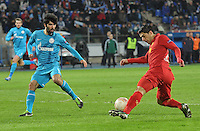 Thu., Feb. 14, 2013, Russia, St. Petersburg. .Zenit St. Petersburg's Netu, left, against Liverpool's Luis Suarez in the UEFA Europa League's last 32 match..Kommersant Photo/Alexander Petrosyan .