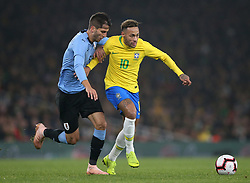 Brazil's Neymar (right) and Uruguay's Rodrigo Bentancur battle for the ball