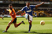Ipswich Town midfielder Liam Feeney holds off Wolverhampton Wanderers midfielder Jack Price during the Sky Bet Championship match between Wolverhampton Wanderers and Ipswich Town at Molineux, Wolverhampton, England on 2 April 2016. Photo by Alan Franklin.