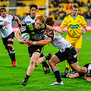 Finlay Christie tackled during the Super Rugby union game between Hurricanes and Sunwolves, played at Westpac Stadium, Wellington, New Zealand on 27 April 2018.   Hurricanes won 43-15.