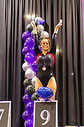 Young gymnastic athletes celebrate their wins on the podium; Region 4 Trampoline & Tumbling Meet; Duke Energy Center, Cincinnati, OH, USA.