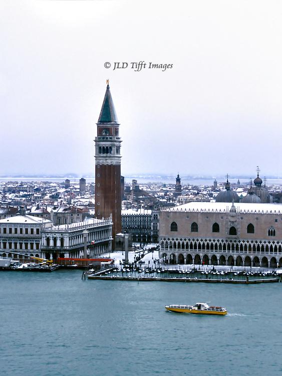 Venice under snow seen from the campanile of the Palladian church of San Giorgio Maggiore..