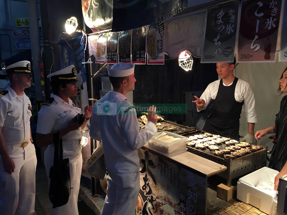 SHIMODA, Japan (May 20, 2017) Sailors from the guided-missile destroyer USS Mustin (DDG 89) enjoy the Shimoda Black Ship Festival. The Navy's participation in the festival celebrates the heritage of U.S.-Japanese naval partnership first established by Commodore Matthew Perry's 1853 port visit. (U.S. Navy photo by Daniel A. Taylor/Released)170520-N-WC492-773<br />